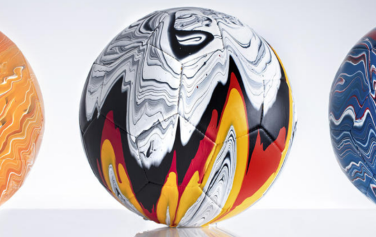 Artist's fusion paint-pouring project turns national football strips into colourful marbled balls